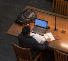Student Studying in Carnegie Library Reading Room