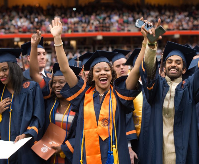 Syracuse graduates cheering at Commencement